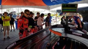 Myer Shank racing drivers race slot cars at Wakins Glen