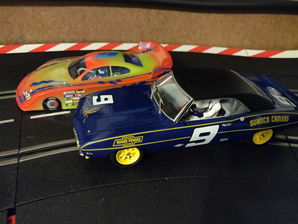 """High speed """"Flexi"""" car at left, realistic """"Scaleauto"""" car at right."""