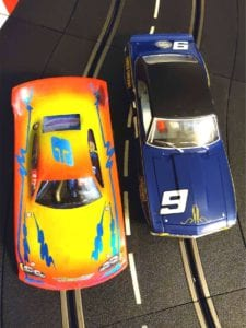 "High speed ""Flexi"" car at left, realistic ""Scaleauto"" car at right."