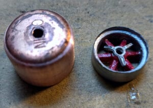 Slot car wheels made from copper pipe fittings.